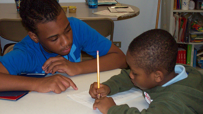 teen mentors a boy at a SAY Yes Center in the inner city