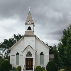 Small church exterior on overcast day.